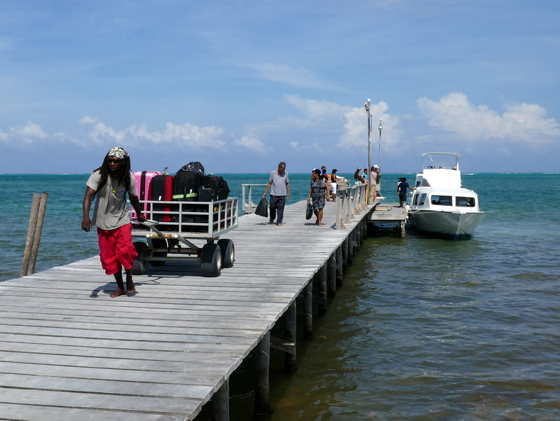 A Creole drags lugage onto Caye Caulker, Belize.