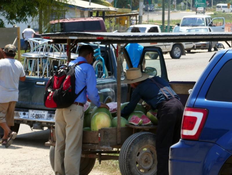 A Mennonite sells watermelons near Belmopan, Belize.