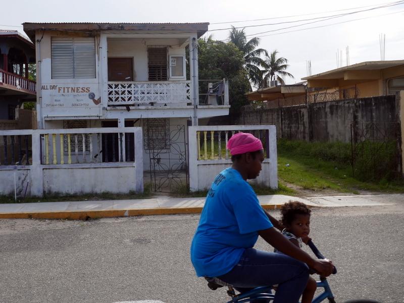 Garifunas on a bicycle in Dangriga, Belize.